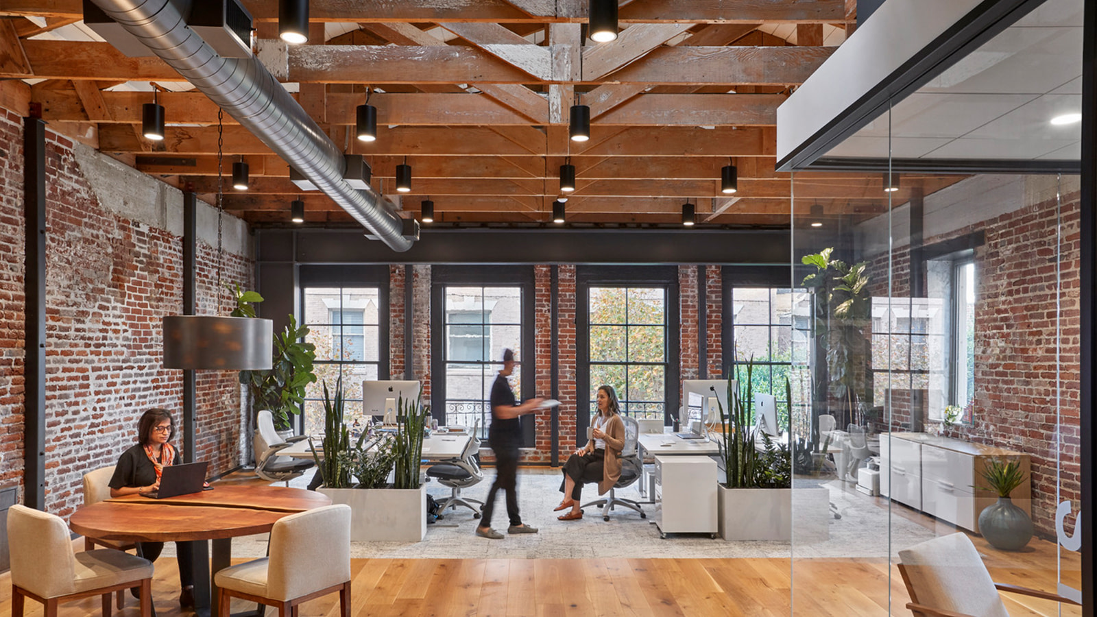 The brick-walled workspace of 01 Advisors