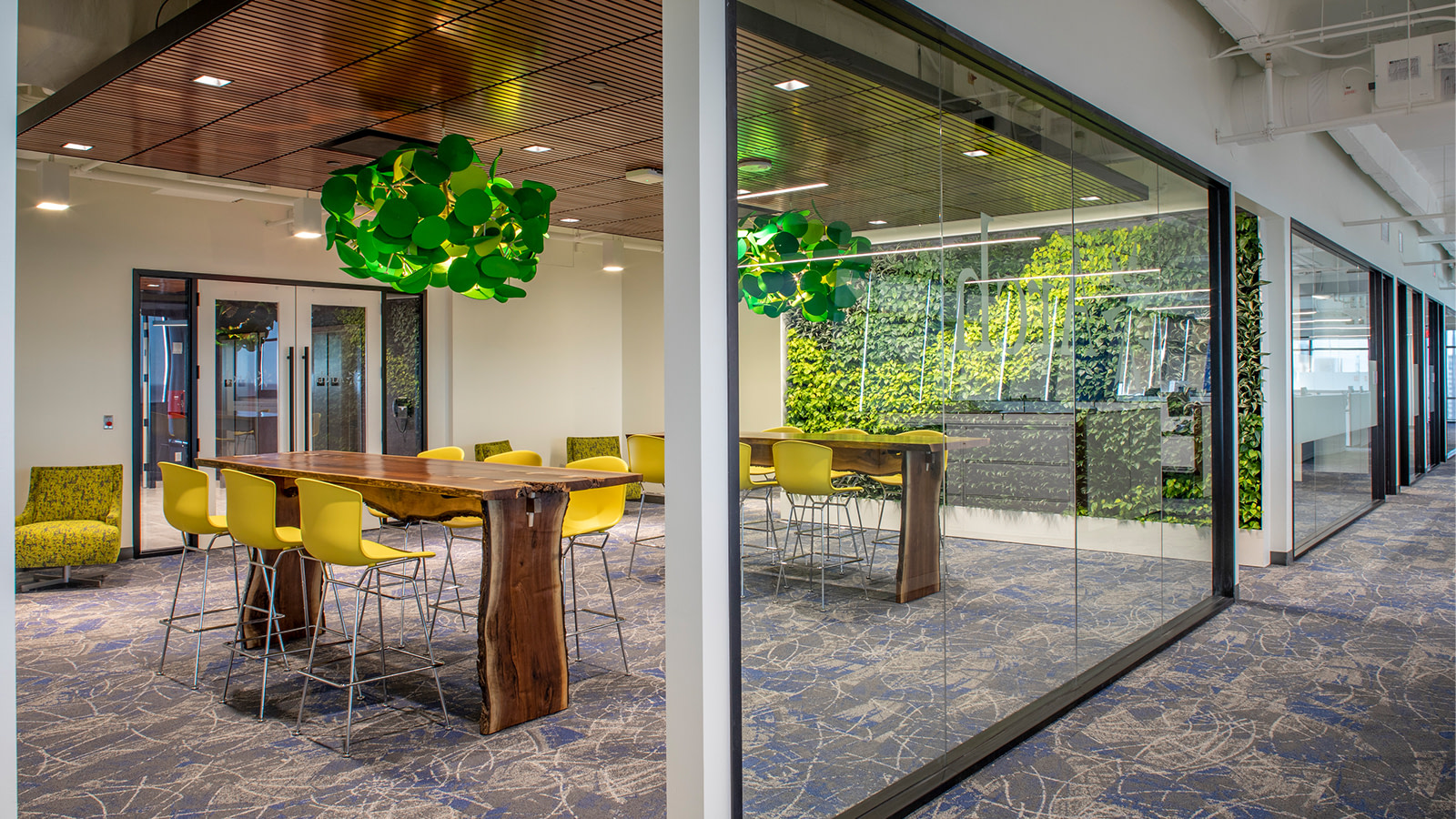 An enclosed work/meet space at Arch Insurance