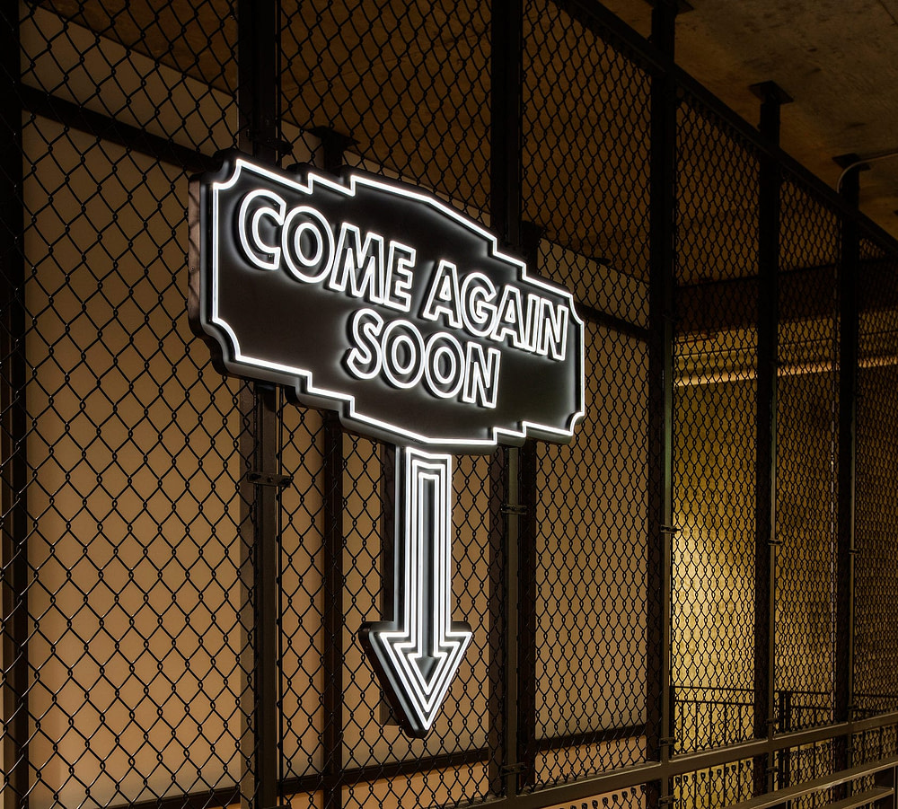 Neon lighting in use as directional signage in Seattle