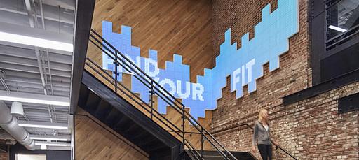 Brand wall with digital display