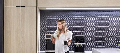 An employee checking her mobile phone in the workplace