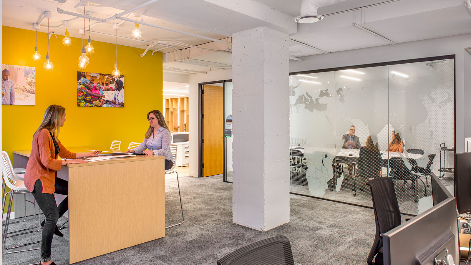 The graphic designs incorporated into this non-profits headquarters focus on the people they serve.
