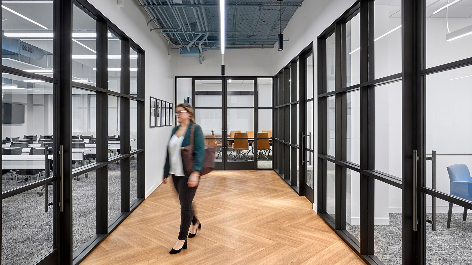 A hall leading to multiple meeting spaces within the Leviton showroom space.