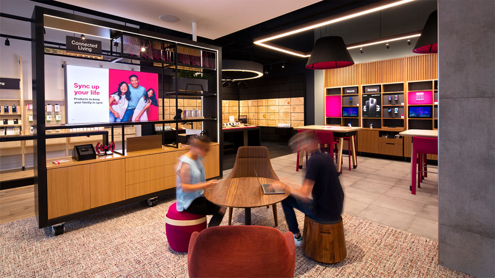 Guests visit a T-Mobile Experience Center