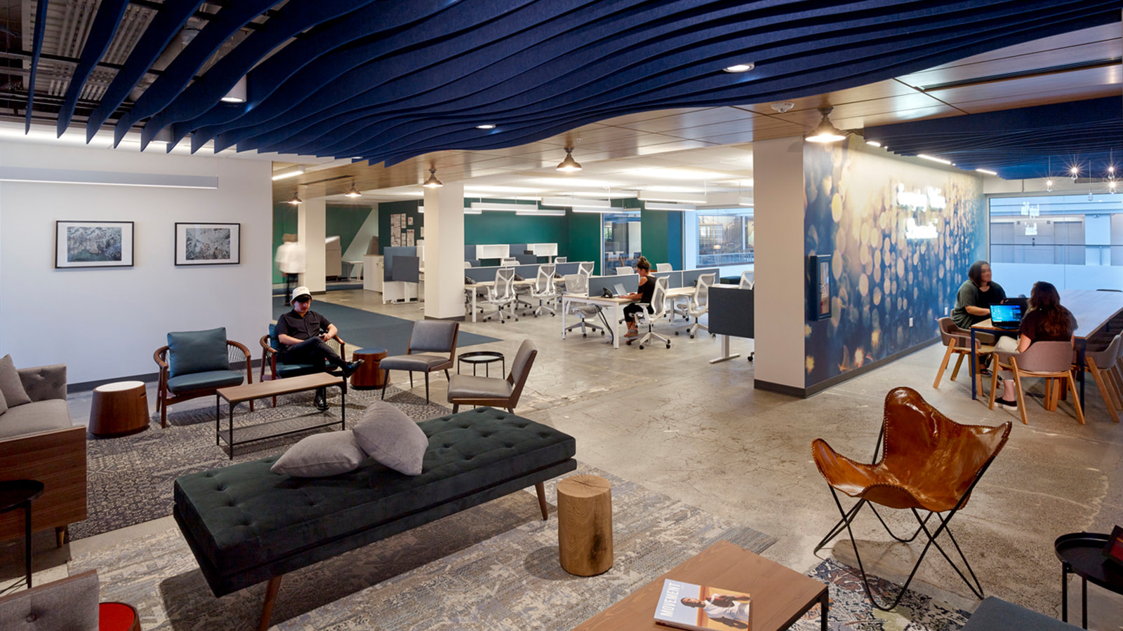 Rugs and furniture at huddle areas adjacent to the Whole Foods Seattle open work space.