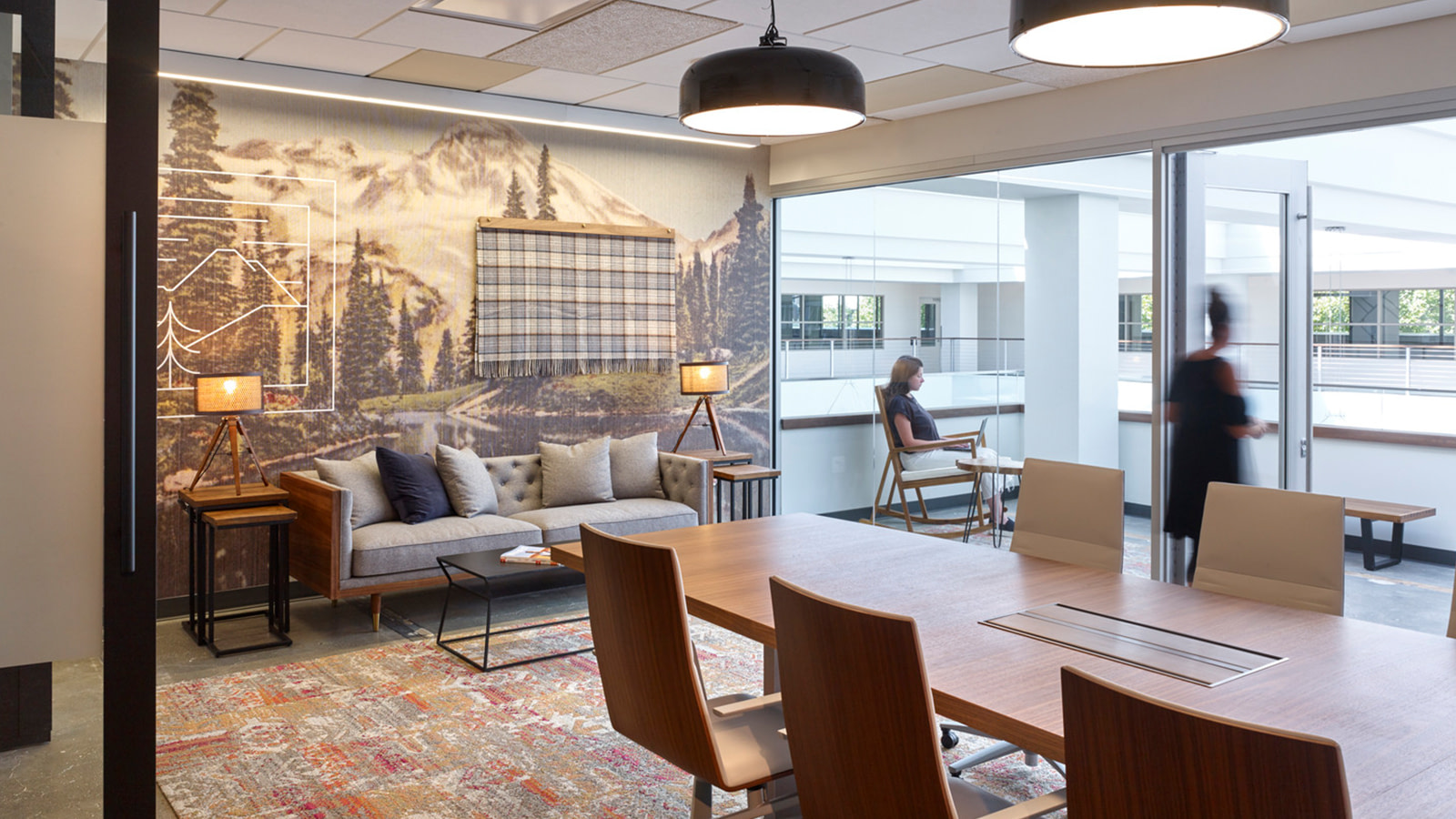 The Seattle offices of Whole Foods show a knit blanket in front of a wallpapered mountain landscape.