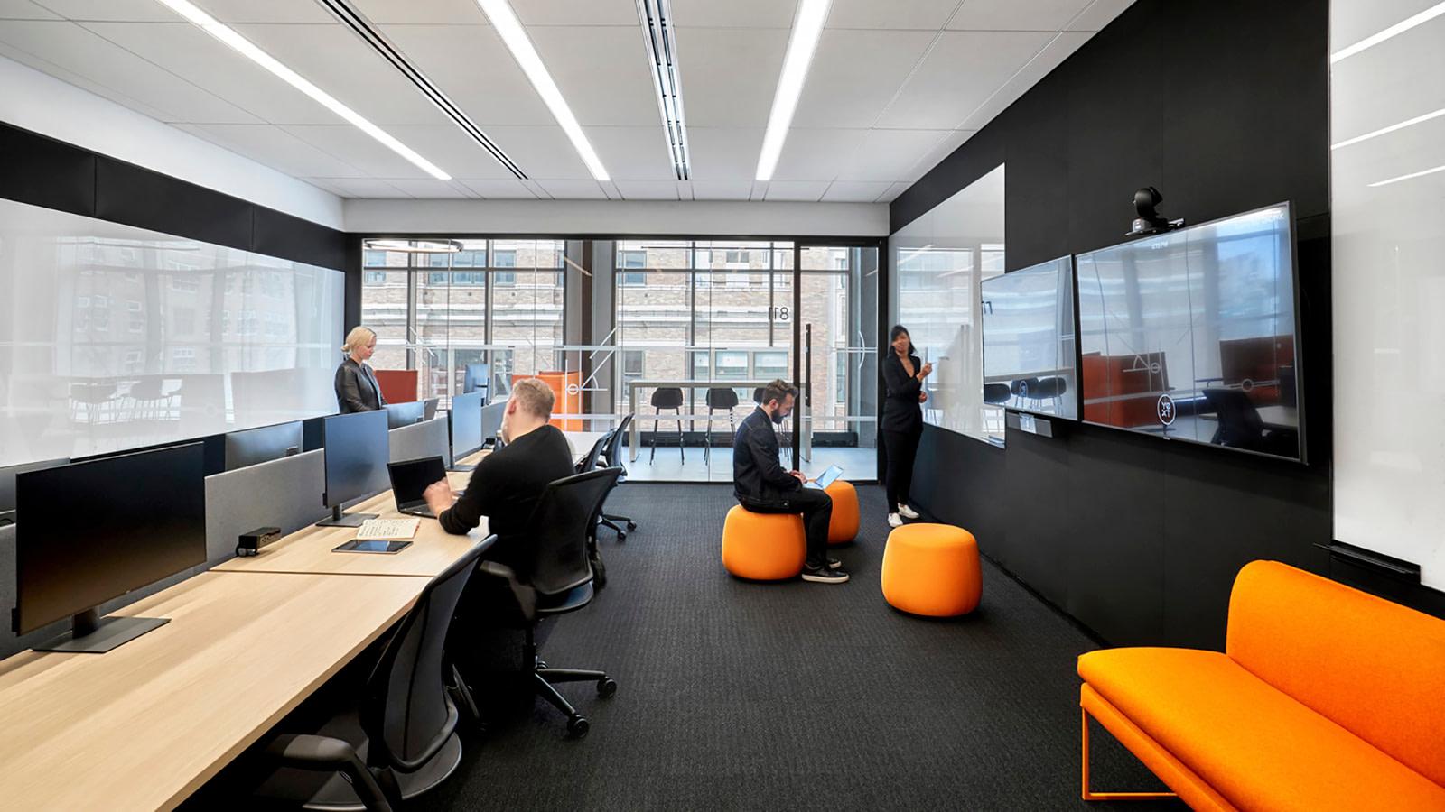 Yext NYC offers flexible seating around standing desks